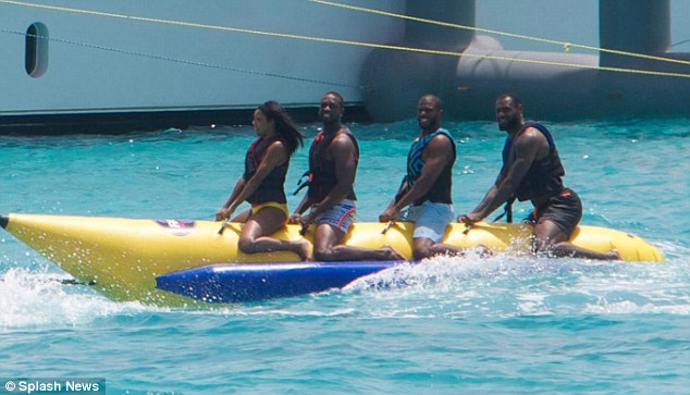 Playful nature: Also accompanied by fellow MBA superstar Chris Paul, the group were seenenjoying a ride on a banana boat