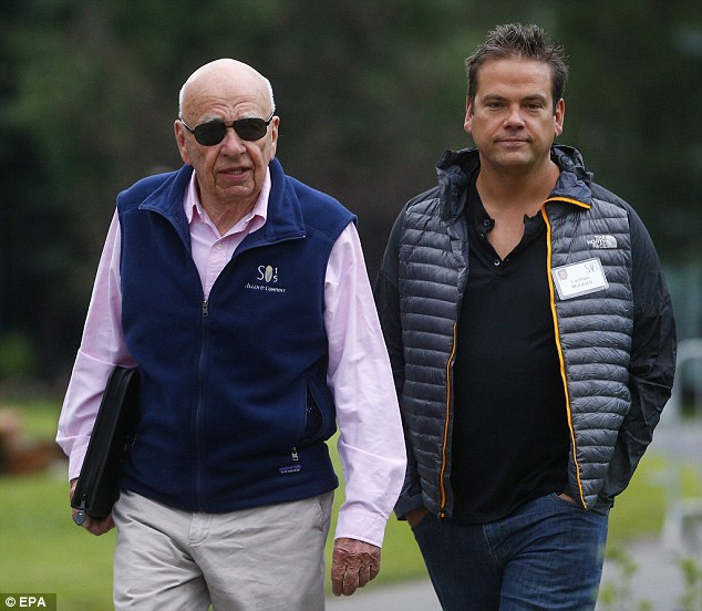 Rupert Murdoch (left) and his son Lachlan (right) walked to breakfast in vests on Wednesday morning