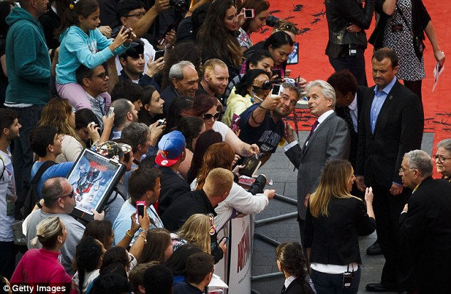 Mobbed: The 70-year-old star was surrounded by eager fans armed with camera phones