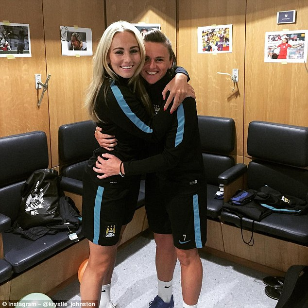 Toni Duggan (left) posed with Manchester City team-mateKrystle Johnston on her return to training