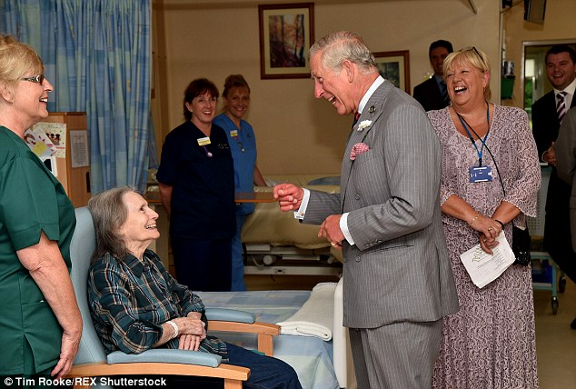 All smiles: The Prince of Wales chats to a patient at the Llandovery Hospital in Carmarthenshire