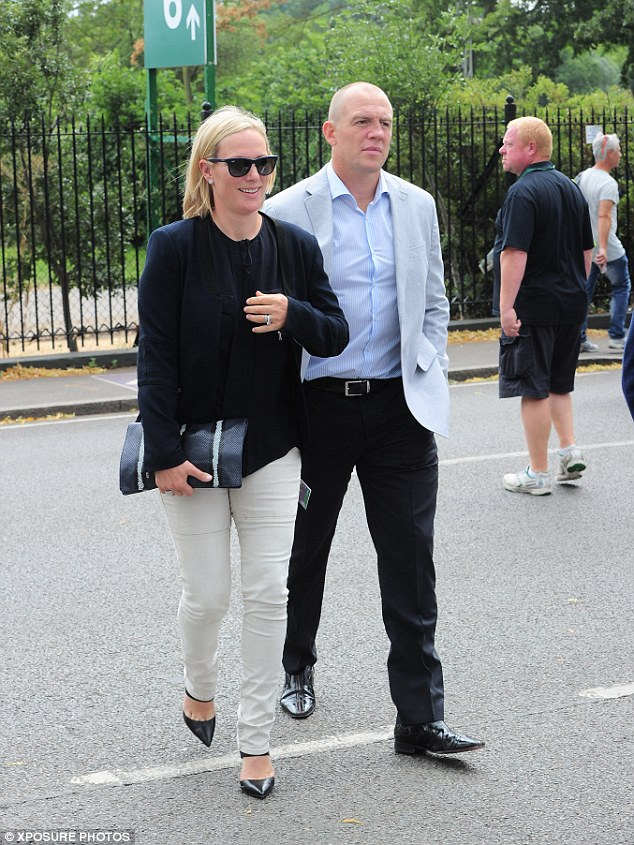 Looking good: Zara Tindall arrived looking lovely in a tailored black top and beige jeans alongside husband Mike