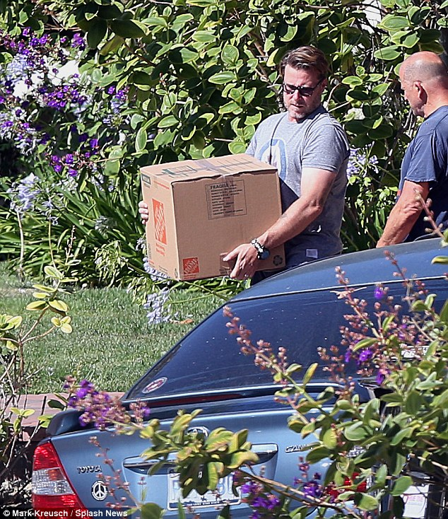 Moving on: Dean, 48, carried a box out to the truck they had rented for the move