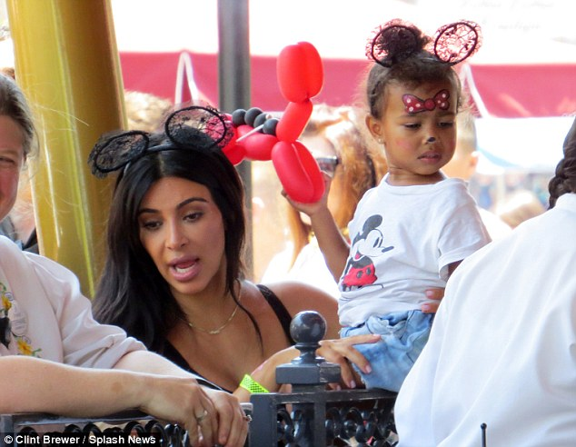 She was at the park only a month ago: North with Kim at her second birthday party at Disneyland in June