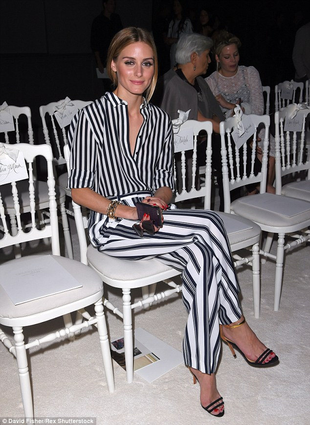 She's earned her stripes: Olivia's looks over Paris Haute Couture week have been second to none, including her clashing striped look at the Giambattista Valli show on Monday