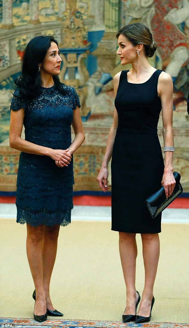 Queen Letizia showcased her slimline figure in a sleeveless black cocktail dress (right), while The First Lady of Peru looked similarly elegant in a navy blue dress (left)