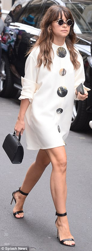 City chic: Kristina Bazan (left) andMiroslava Duma (right) both pulled out all the stops in black and white ensembles