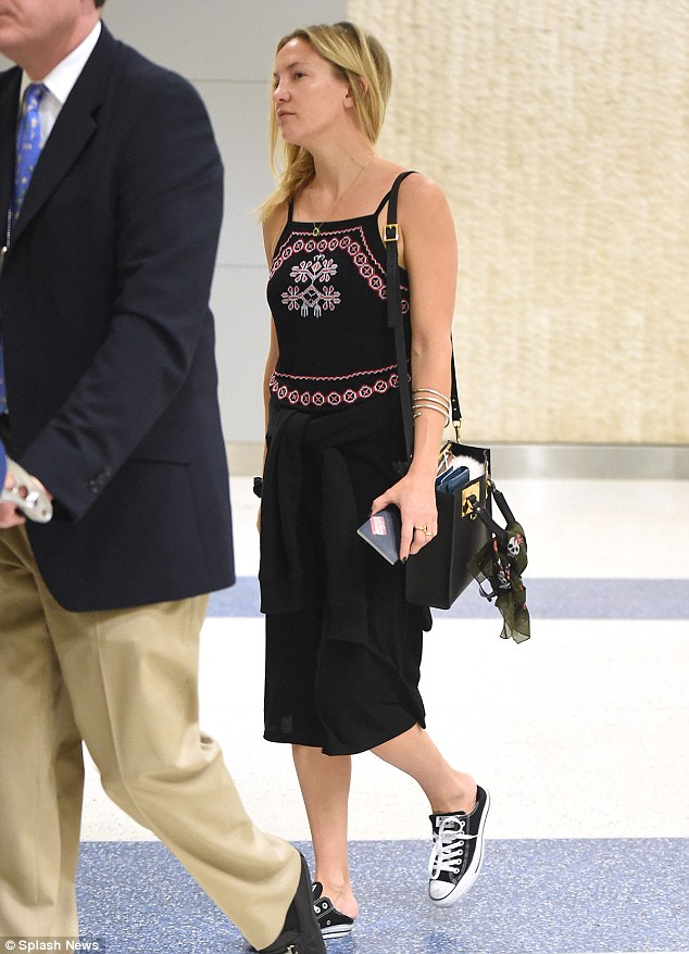Cool: The actress wore a black sundress with an embroidered bodice and Converse sneakers