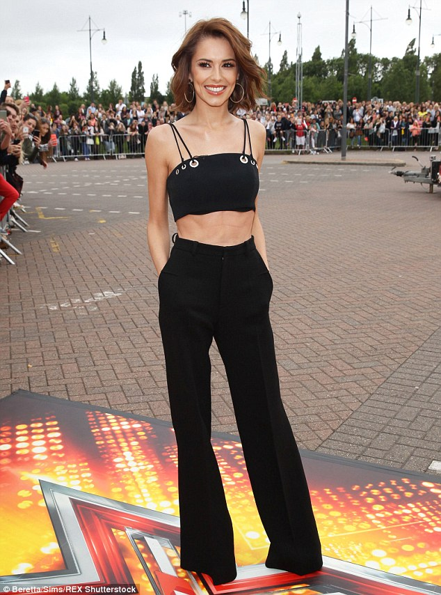 Slimline: Cheryl Fernandez-Verskini showed off an extremely slender frame as she arrived for the first day of X Factor auditions in Manchester on Wednesday
