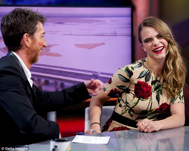 Funny girl: Cara joked around with host Pablo Motos after giving him a lipstick mark on his cheek