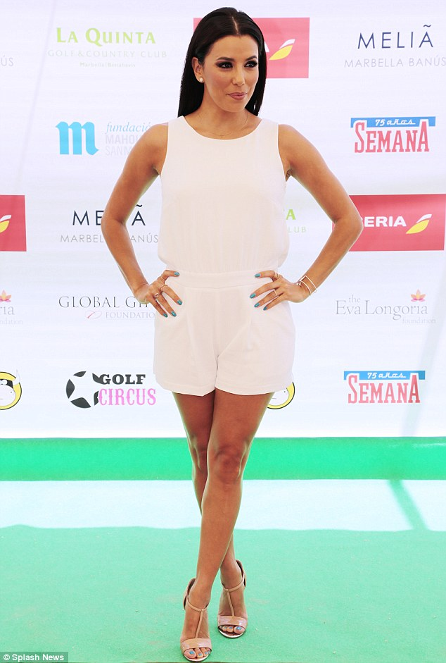 Friday... It was business as usual when she attended charity golf tournament in a sleeveless white playsuit