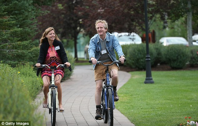 Amid all the fleeces, Latham & Watkins marketing officer Elizabeth Hughes Eginton (left) and Chris David (right) arrived pedaling bicycles on Wednesday