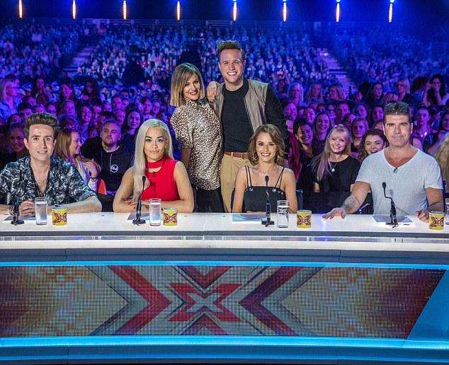 New line-up: The 2015 X Factor Judges Simon Cowell, Cheryl Fernedez-Versini, Rita Ora and Nick Grimshaw took their places with the brand new show hosts Caroline Flack and Olly Murs