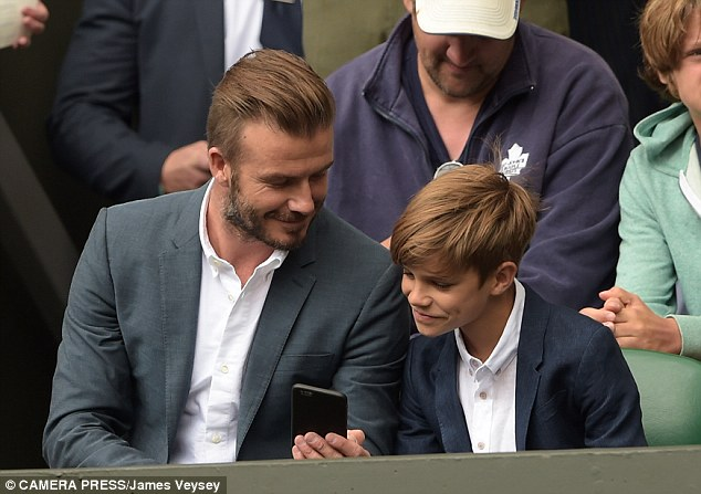 Check it out: Romeo leaned in to look at an item on his father's phone