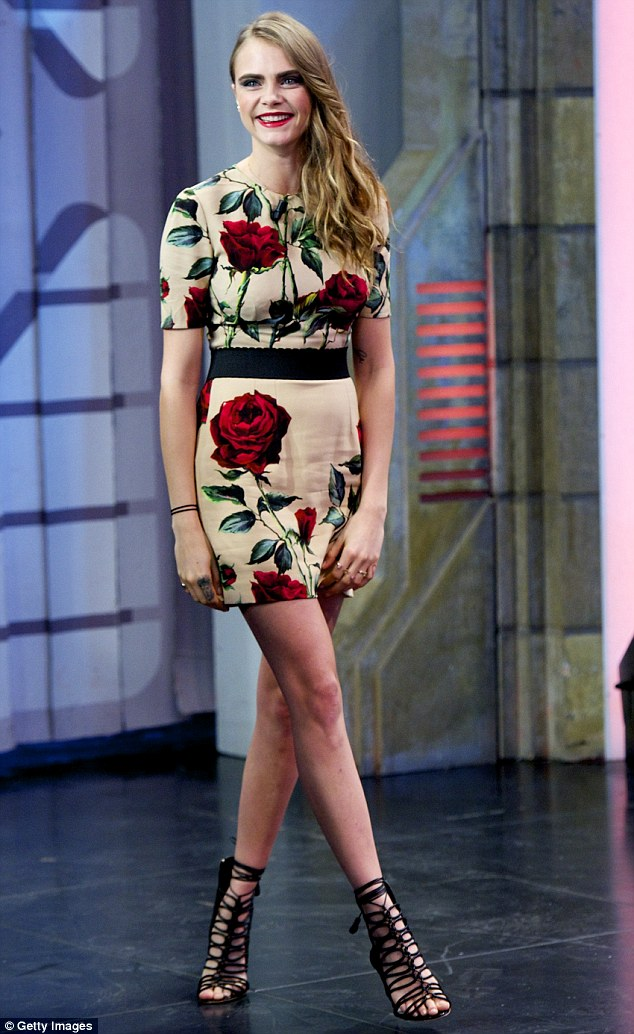 Legs ahoy: The stunning model looked overjoyed to take part in the popular showEl Hormiguero - meaning 'The Anthill' while promoting Paper Towns
