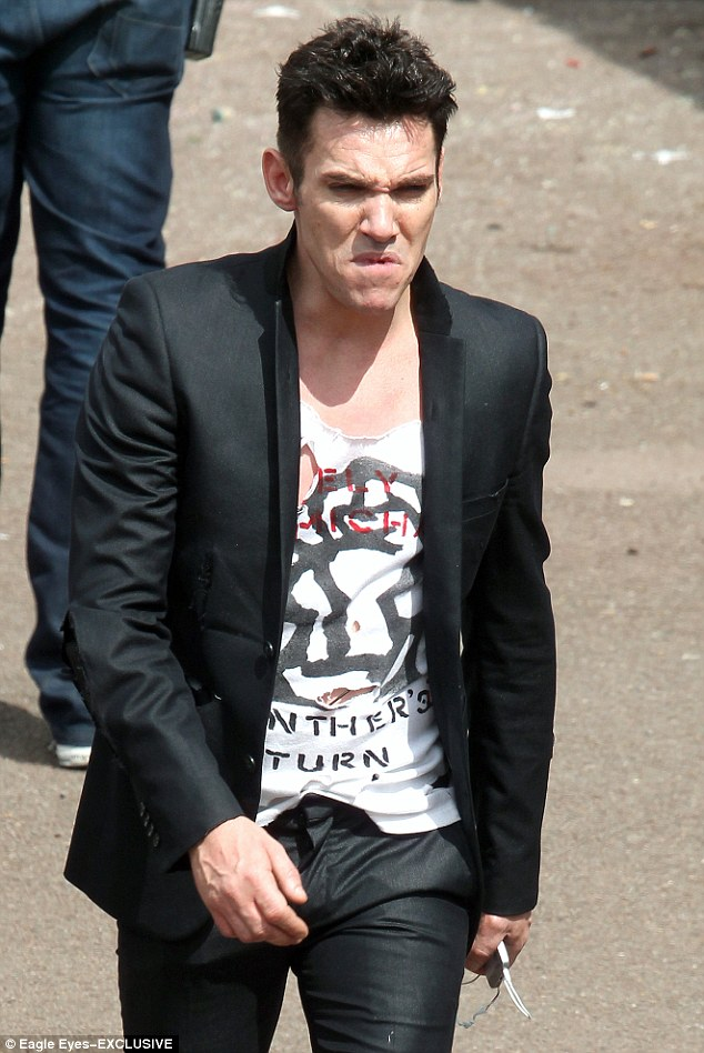 Edgy look: He donned ripped trousers, a slogan tee and a blazer to play the London Calling singer