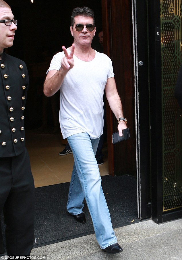 Back to business: Simon Cowell made his first public appearance on Wednesday for the Manchester auditions of The X Factor, three days after his mother's death