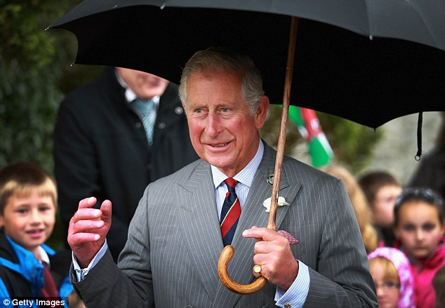 Rainy day: Charles departed sheltering under an umbrella but stopped to chat to well-wishers first