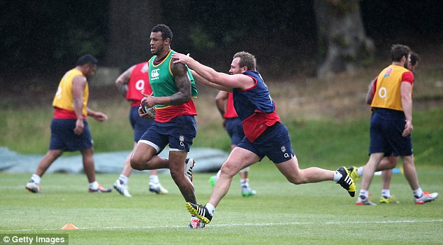 Second row Courtney Lawes breaks away from Matt Mullan as the England stars look to impress their coach