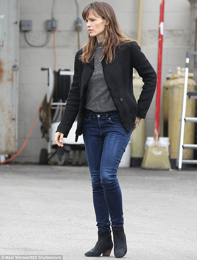 Signature style: The brunette beauty could regularly be seen rocking dark tops and blue jeans while make-up free like in this outing in Los Angeles back in December