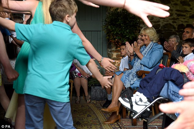 The Duchess of Cornwall watches a performance by the Carmarthen Youth Opera