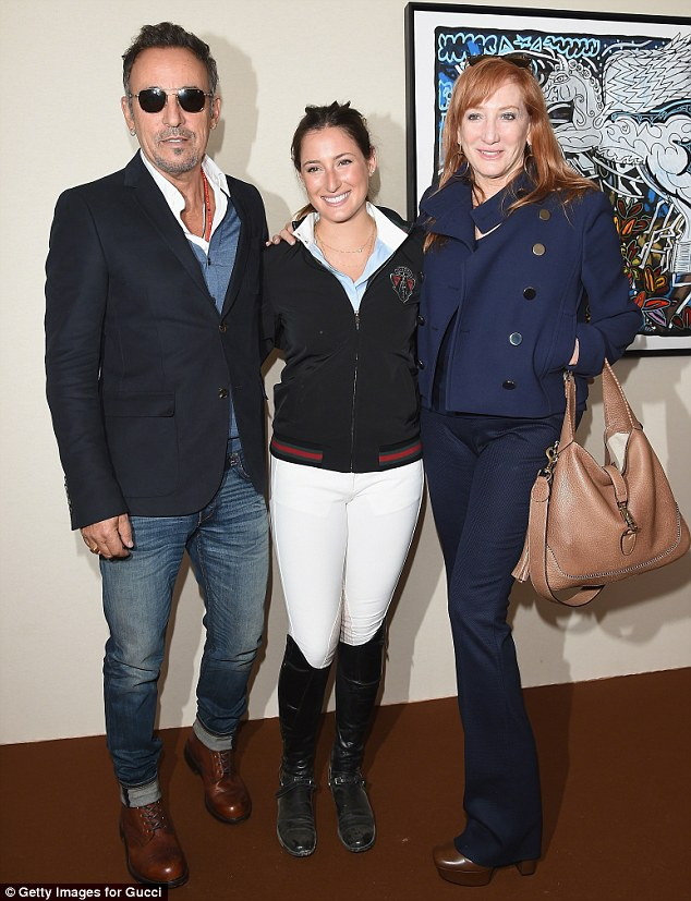 Support: Her mother and father have always encouraged her love of riding - she is pictured here with her parents Bruce Springsteen and Patti Scialfa at the Paris Eiffel Jumping Tournament in July 2014