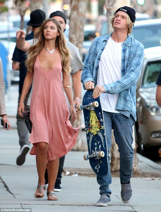 Buying something for his ladylove? The pair were seen going shopping together and Cody took along his skateboard