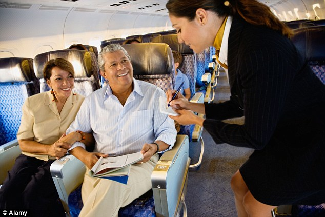 If faced with a three-seat configuration book the window and aisle seat as the middle seat tend to sell last, meaning you and your partner could have your own row
