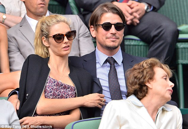 Getting into it! The couple looked happy as they watched the match between Murray and Pospisilfrom their VIP seats
