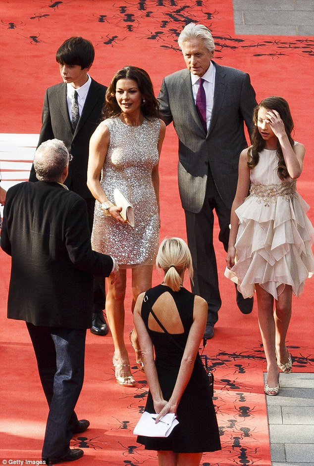 Photogenic family: Michael ushered his wife and children down the red carpet