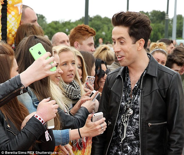 Greeting his fans: Nick also stopped to chat and take pictures as he got his X Factor career off to a good start