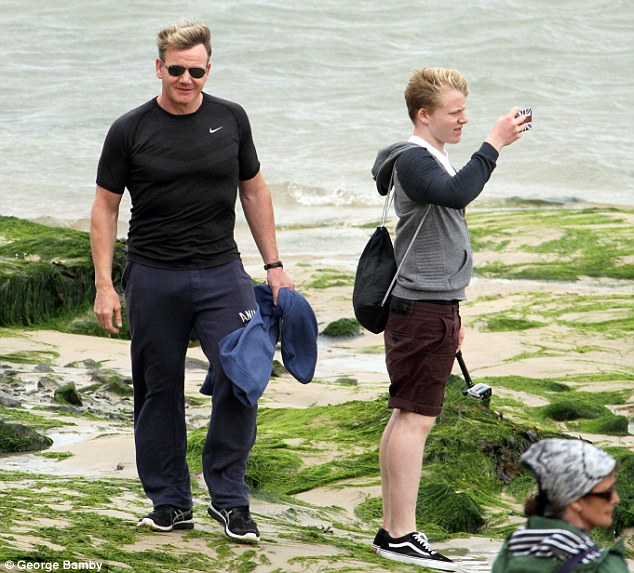 Keeping his cool: Dressed down in a plain black T-shirt and slouchy trousers, Gordon appeared to be in great and content spirits as he enjoyed some alone time with his family