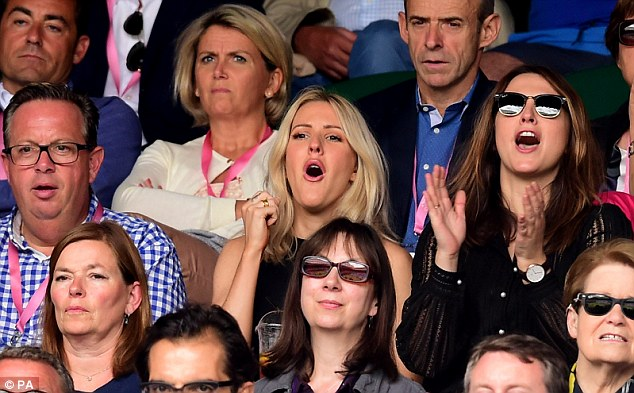 Celeb cheerleader: Ellie was engrossed in the action on centre court as she watched the Andy Murray match