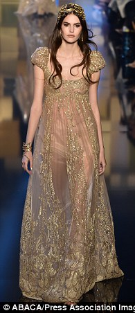 The theme: A lot of the designs included clothing with elaborate trails and semi-sheer fabrics