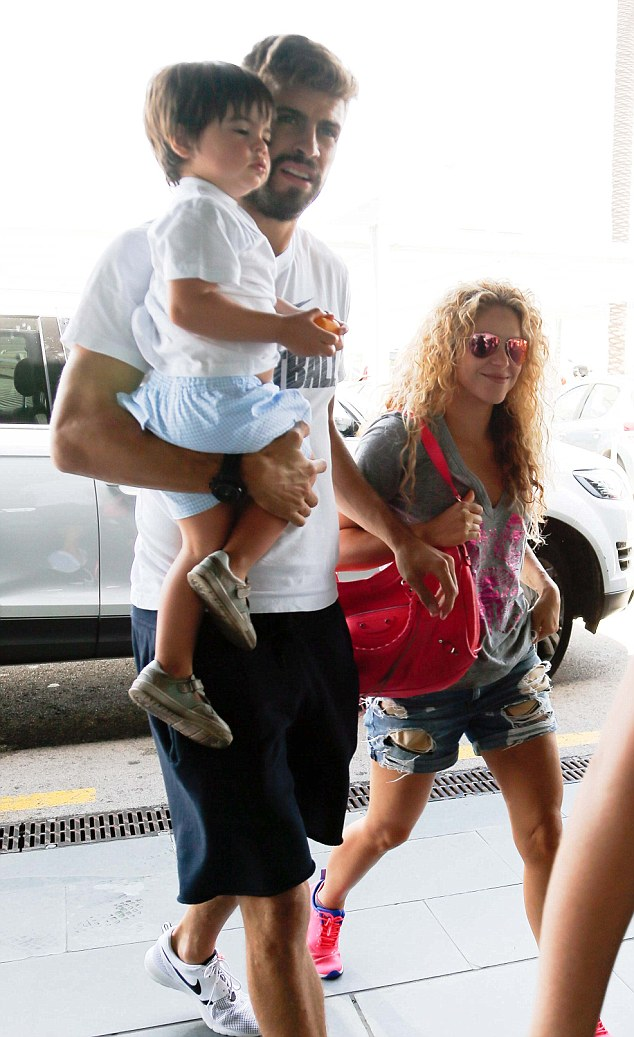 All smiles: Shakira already looked like she was in holiday mode and smiled as she made strides into departures