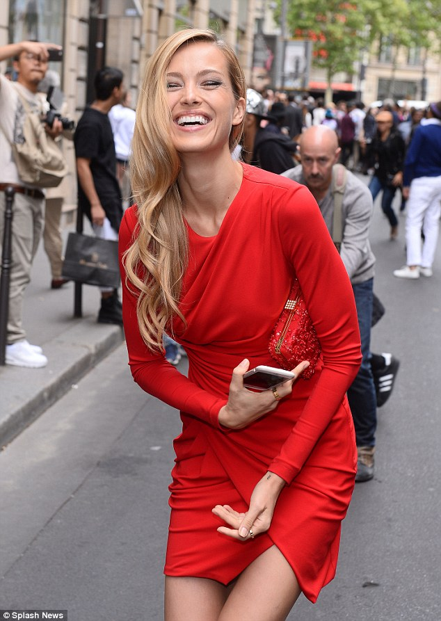 Turning heads: Looking stylish as usual, the 36-year-old model dressed her lean and slender frame in a bold red number