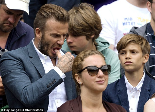 Thumbs up! David Beckham was fussing over his 12-year-year-old son Romeo as they enjoyed the Wimbledon action at Centre Court on Wednesday