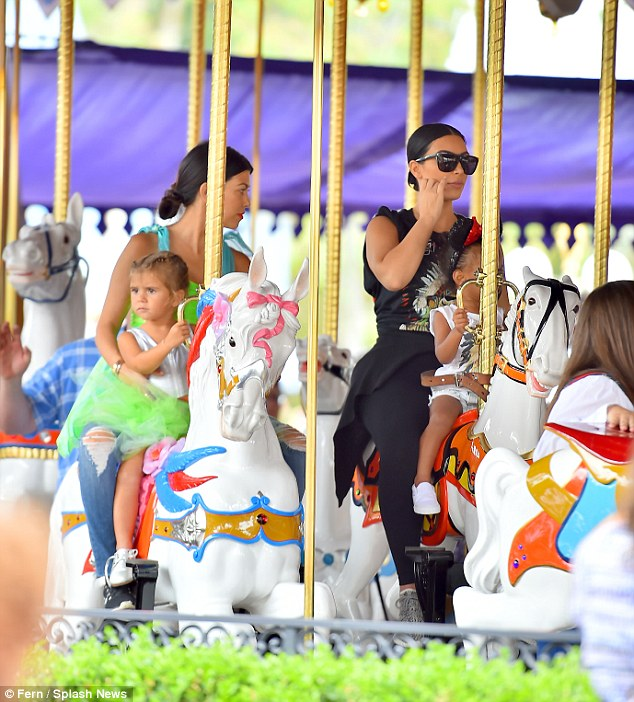 She liked this ride: The youngest E! star looked happy as she held onto her horse on the Merry-Go-Round