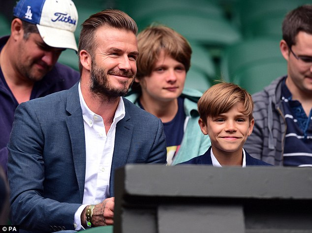 Like father, like son: David Beckham proved his love for all sports as he took his son Romeo along to enjoy day nine of Wimbledon
