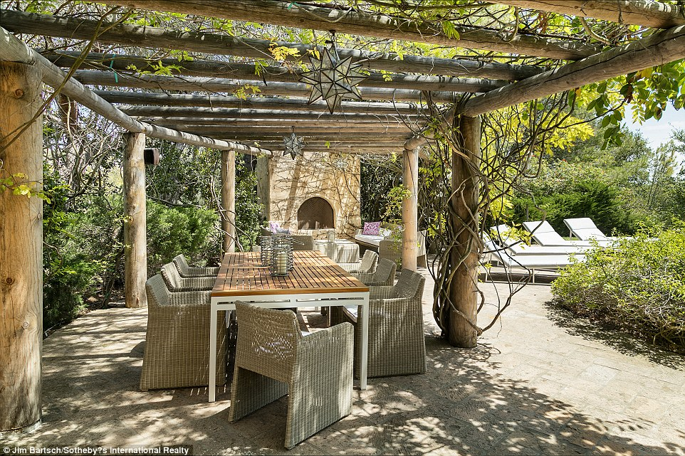 Hideaway: Whoever purchases the home can take shade from the outdoors in this patio near the pool