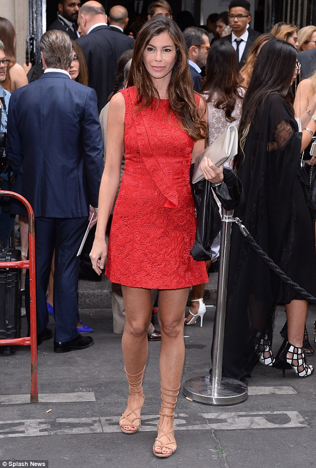 Bold move: Christina Pitanguy stood out in a tiny red dress and nude strappy heels
