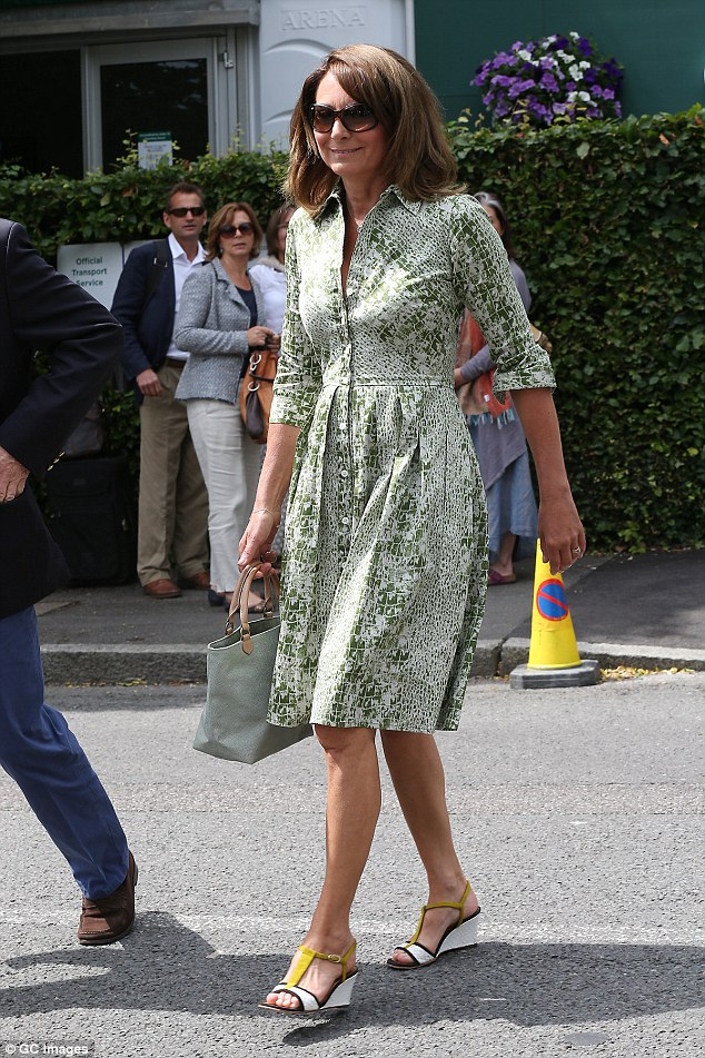 Standing out: Carole looked lovely in a chic green and white dress and statement wedges