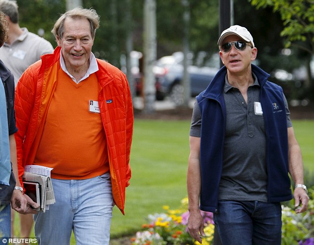 Jeff Bezos, founder and CEO of Amazon.com, arrived in a cap and sunglasses with journalist, television personality and bachelor Charlie Rose in all orange, clutching newspapers and an iPad Mini on Wednesday