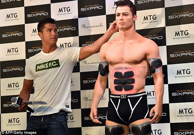 Ronaldo arranges the 3D clone's hair as he answers question on the new fitness piece on Thursday