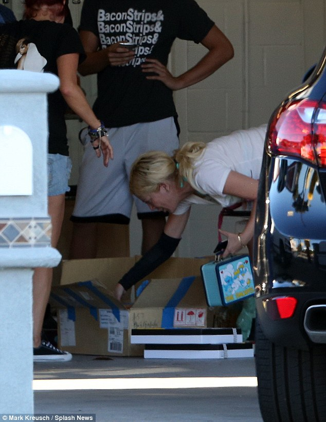 One last look: The blonde reality star rummaged through an open box