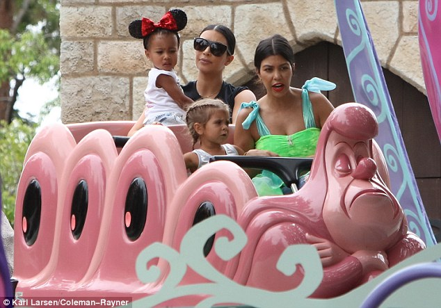 Too scary?: The little one looked a bit upset when she came out of the ride, which has a large cat in it