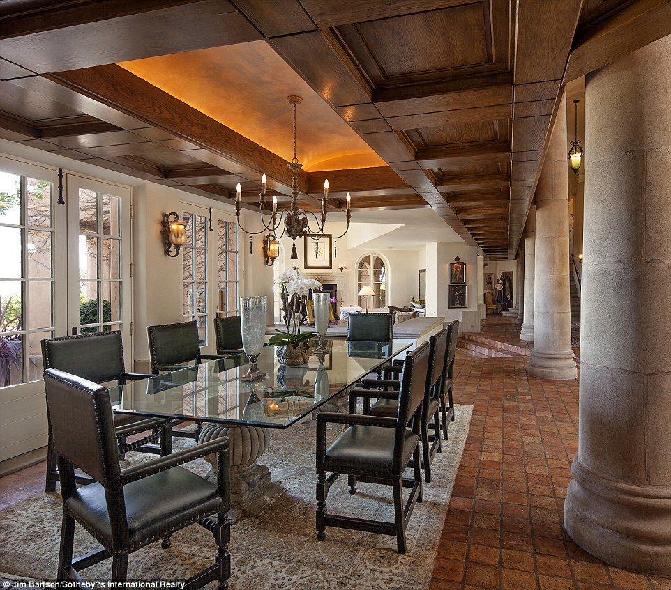 Chow down: French doors are seen alongside the home's dining room, with stone columns nearby