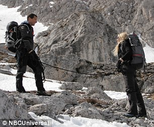 Connected: The pair are shown roped together for safety as they continue their challenging climb