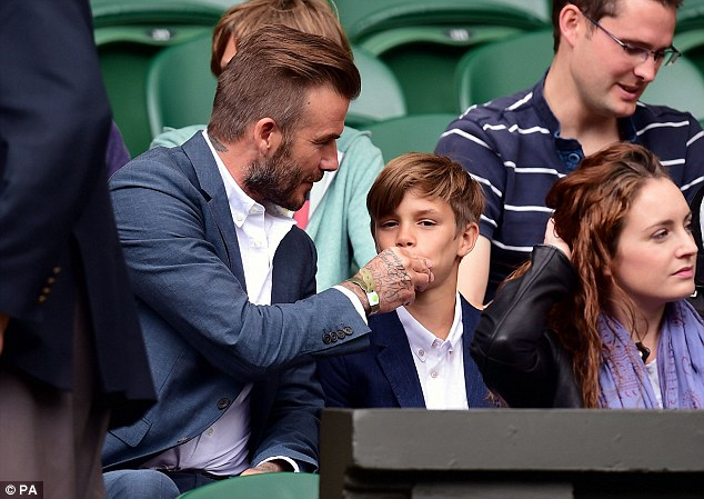Scrubbing up: The handsome star and his son watched Andy Murray face off against Vasek Pospisil