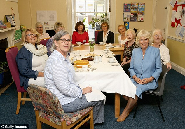 Teatime: Camilla meets ladies from the local WI during a visit to the Llandovery YMCA